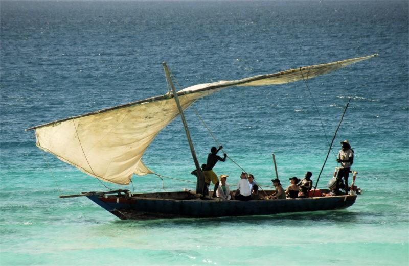 Fishermen going out to sea at sunrise on Zanzibar