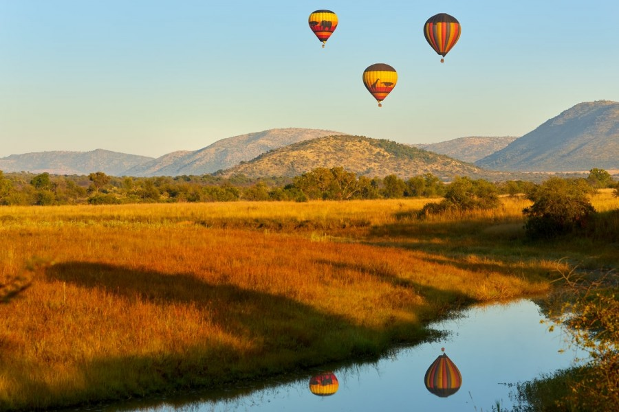 Hot air balloons with tourists above the Pilanesberg National Reserve
